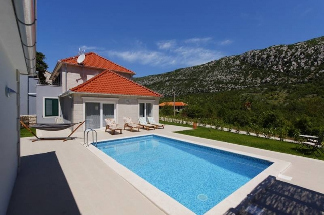 Sunlit Villa Zupa with private swimming pool and sunbeds in the valley of the mountain Biokovo