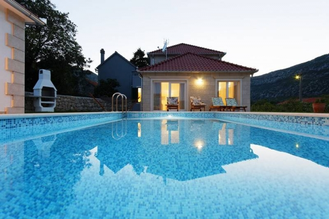 The swimming pool view on the Villa Zupa at the dusk